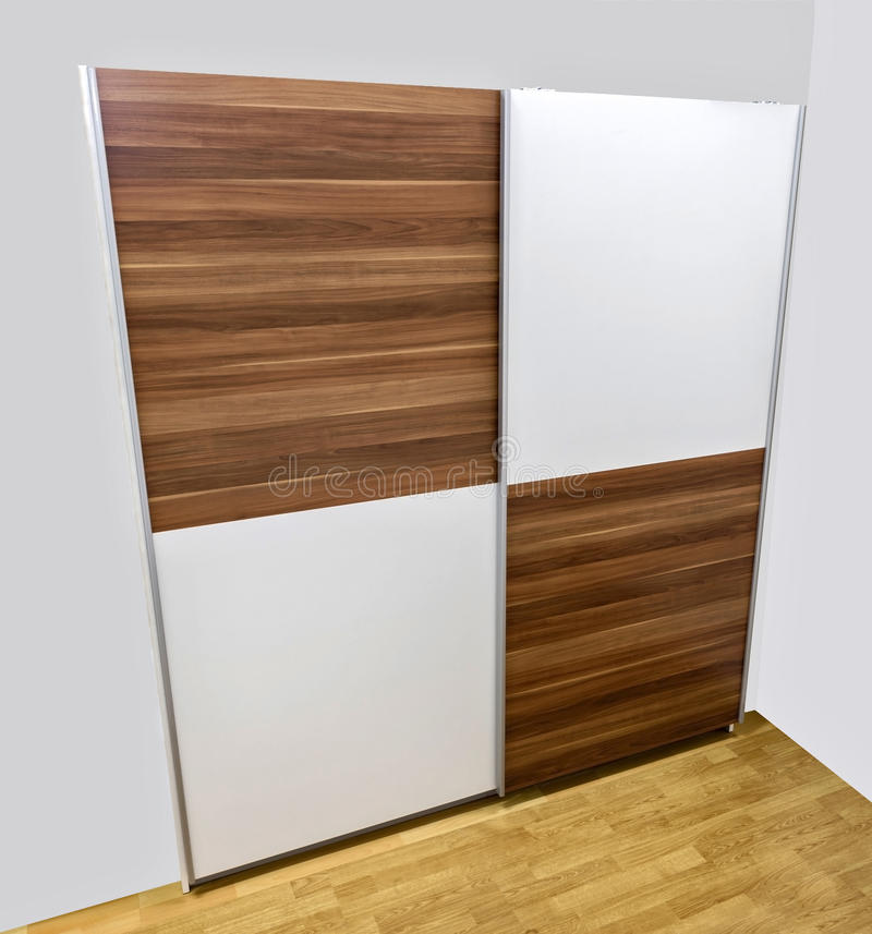 Sliding doors. Two sliding doors, made of laminated chipboard. Two colors combination, white and wood imitatation royalty free stock photography