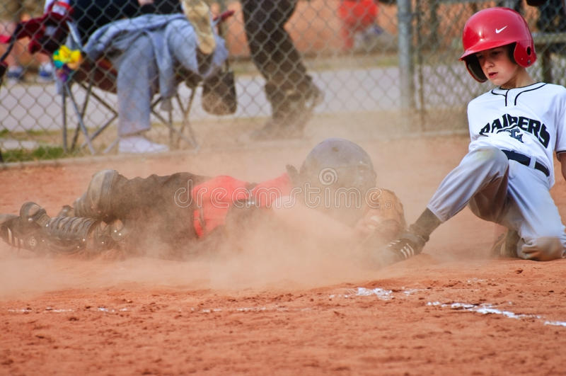 Sliding Into Home/ Boys Baseball stock photography