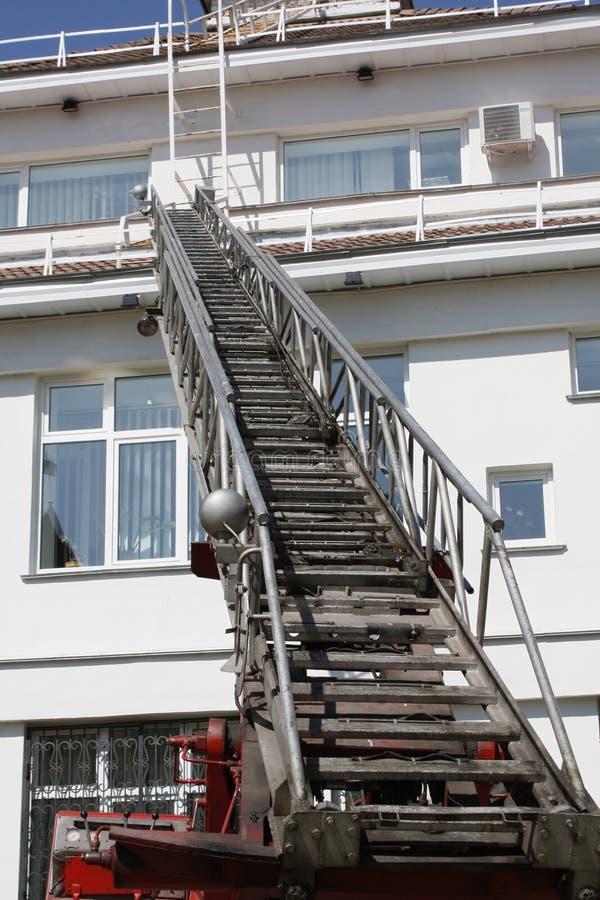 Sliding ladder of the fire truck stock image
