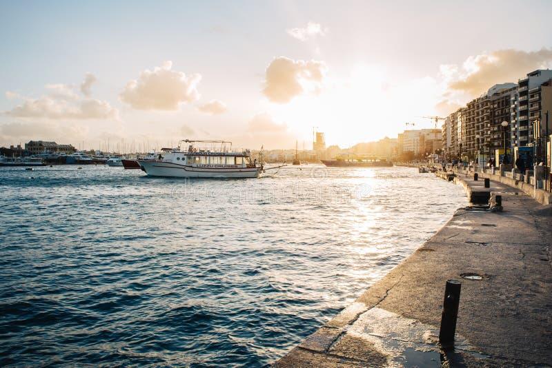 Sliema Ferries waterfront between Gzira and Sliema, Malta at sunset.  stock photography