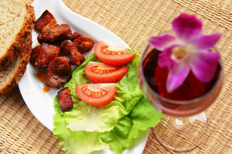 Slight lunch - meat. With salad and bread royalty free stock photography