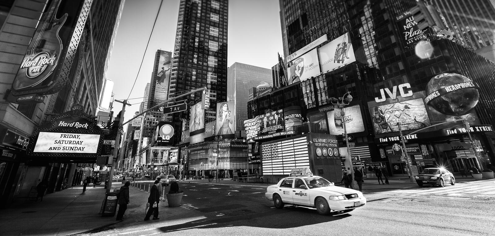 Times Square New York NYC in the morning. A slightly less busy Times Square, New York, NYC in the morning during the usual commute in Black and White stock images