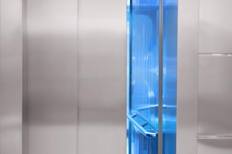 Slightly open elevator door in the mall. A slightly open elevator door in the mall royalty free stock images