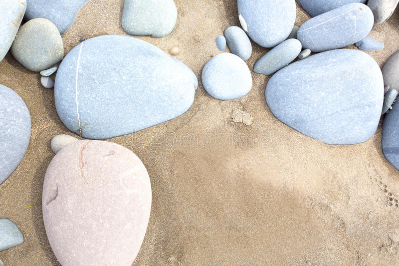 Slightly saturated image of beach pebbles. Blue and golden stones on a beach in the uk royalty free stock photography