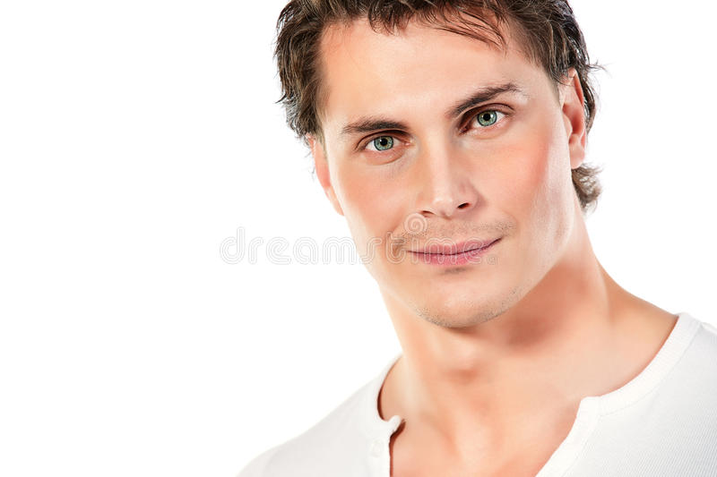 Slightly smiling. Portrait of a handsome muscular young man. Isolated over white background royalty free stock images