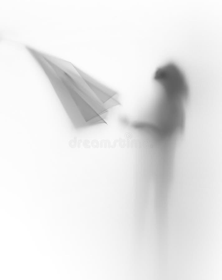 Slihouette diffuso del corpo di una ragazza con l'ombrello fotografie stock