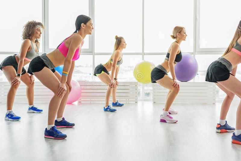 Slim active girls in gym royalty free stock photo