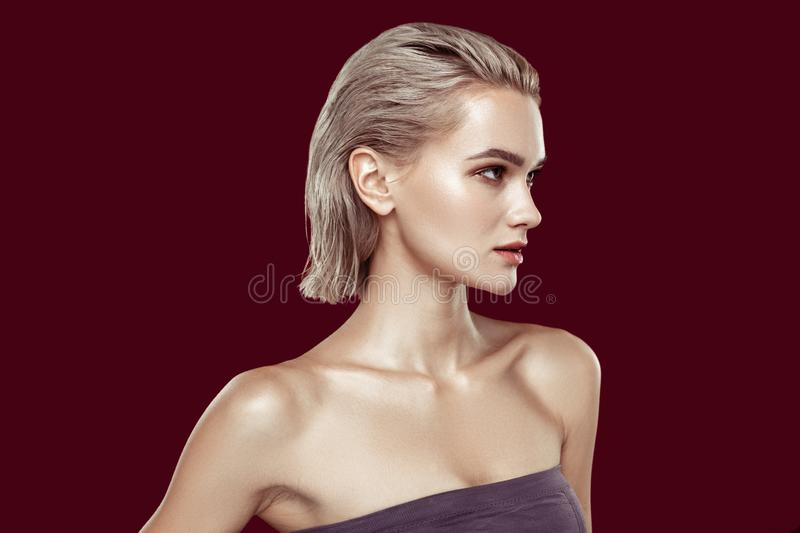 Slim appealing photo model with nice hairstyle and makeup royalty free stock image