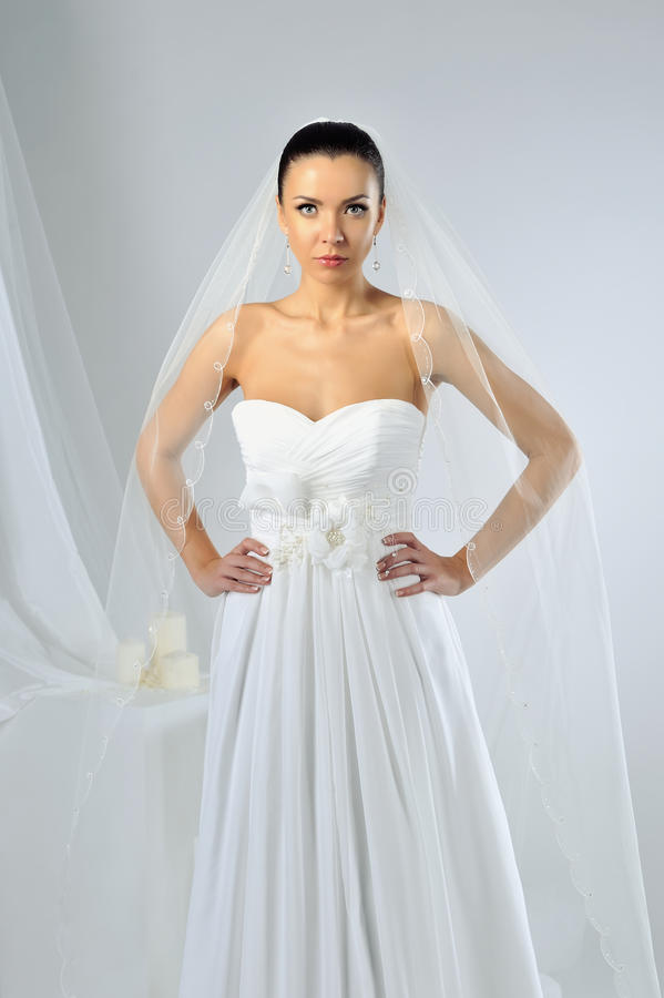 Slim beautiful woman wearing luxurious wedding dress stock photography