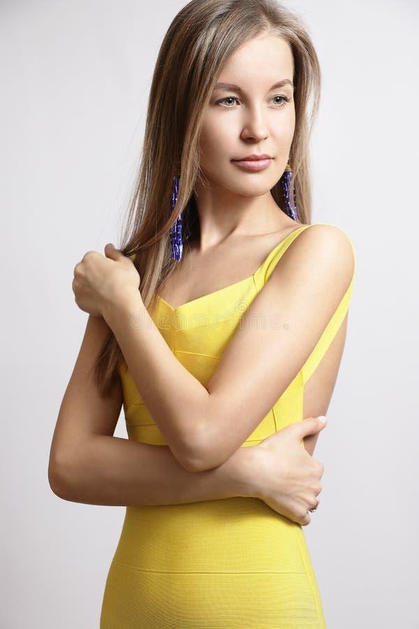 Slim blonde in a dress stock photos