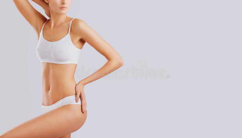Slim body of a young woman in lingerie. stock photo