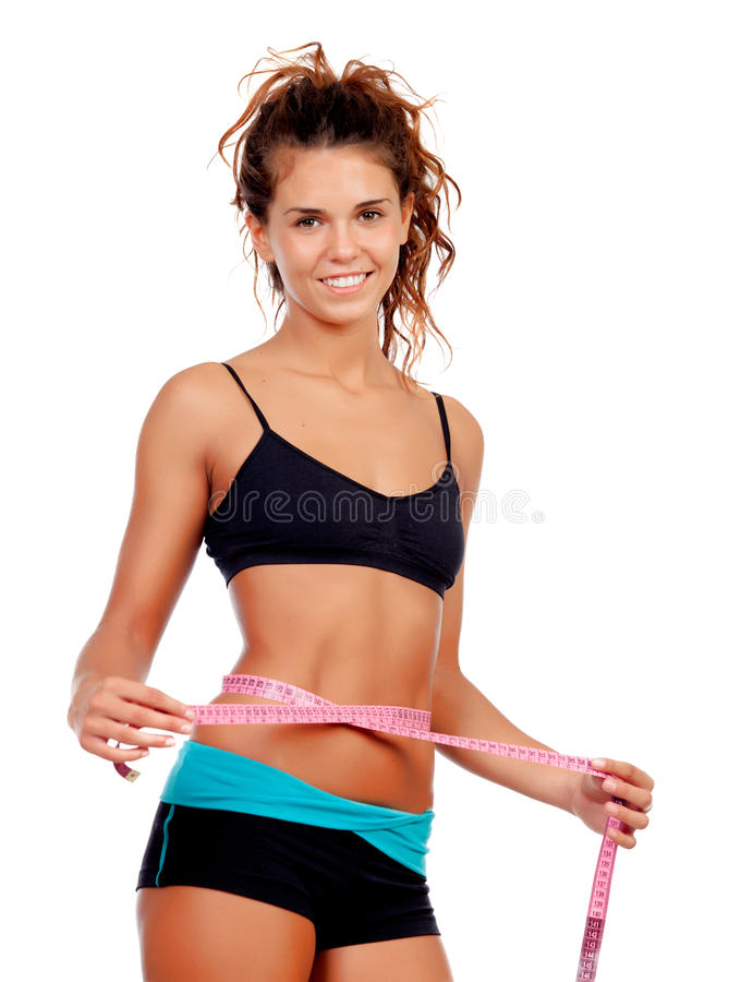Slim brunette girl with tape measure and fitness clothes. Isolated on a white background stock photos