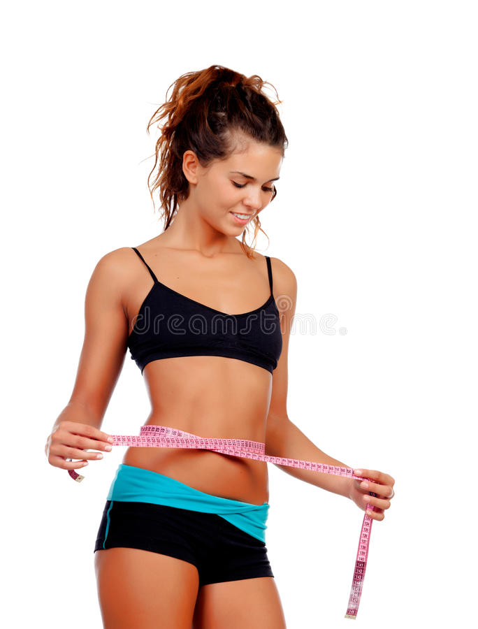 Slim brunette girl with tape measure and fitness clothes. Isolated on a white background stock photo