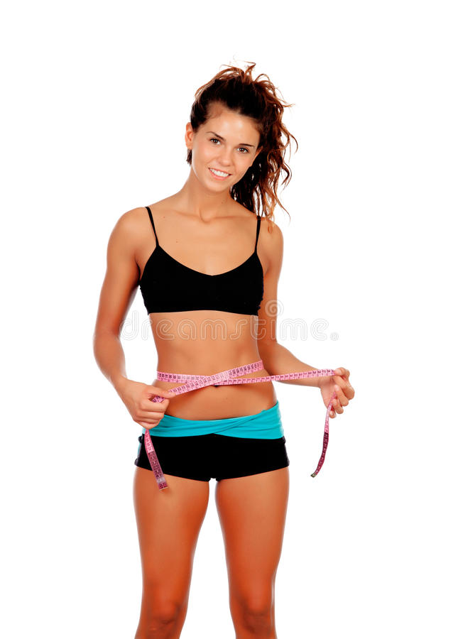 Slim brunette girl with tape measure and fitness clothes. Isolated on a white background royalty free stock photo