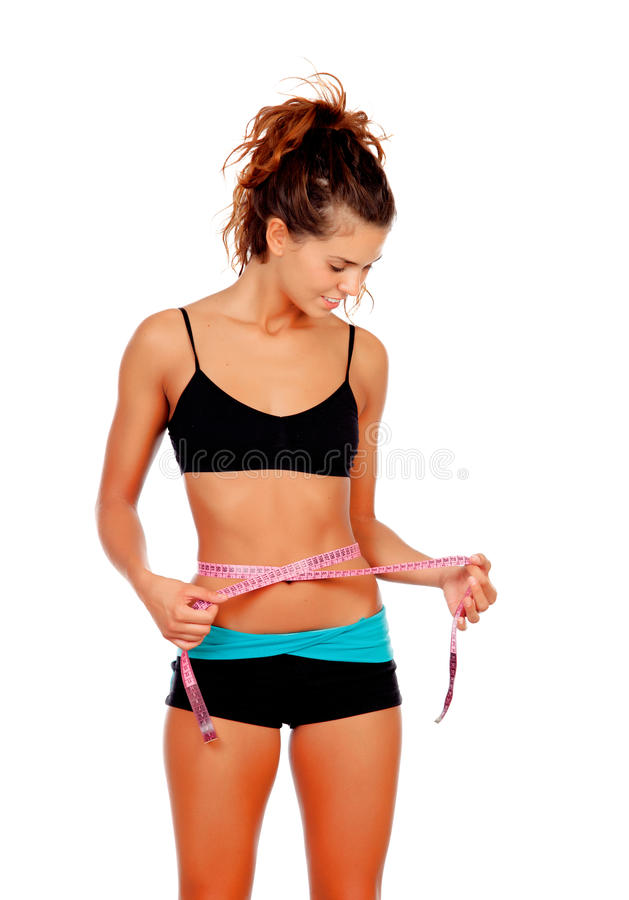 Slim brunette girl with tape measure and fitness clothes. Isolated on a white background stock photography