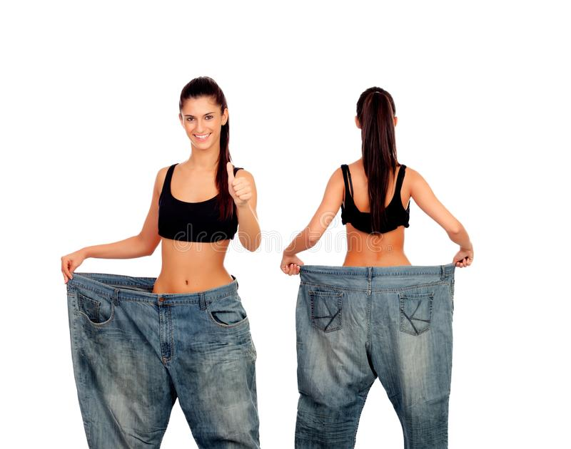Slim girl with big jeans trousers royalty free stock photos