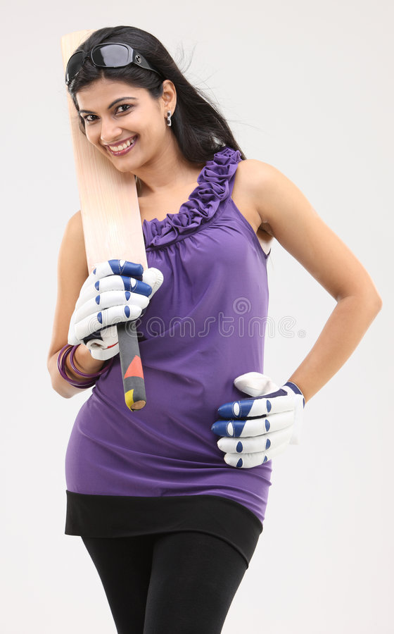 Slim girl with cricket bat royalty free stock photo
