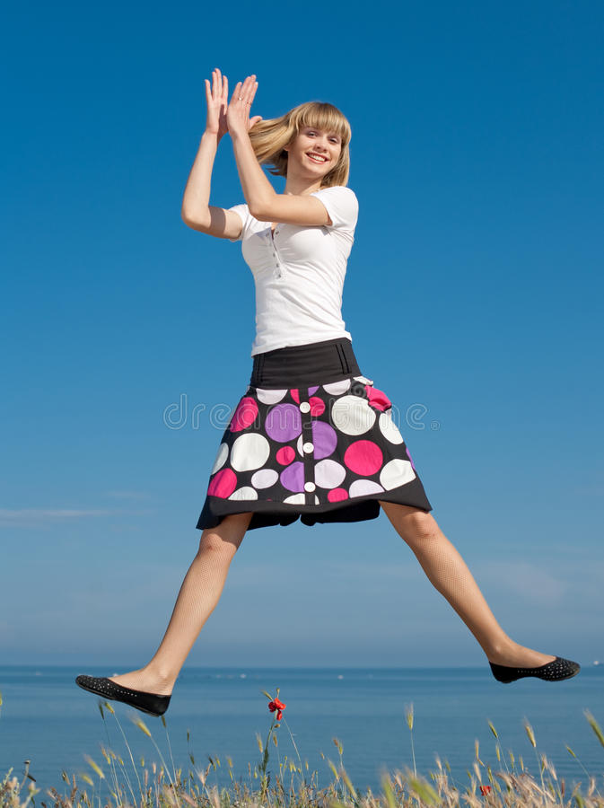 Slim girl jumping royalty free stock images