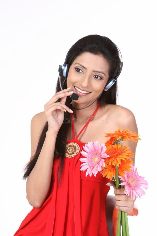 Slim girl with micro phones stock photos