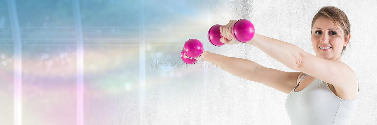 Slim healthy woman holding weights royalty free stock photo