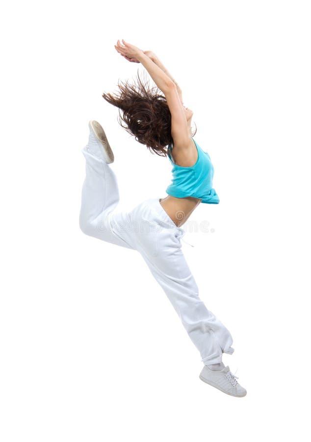 Slim hip-hop style teenage girl jumping dancing