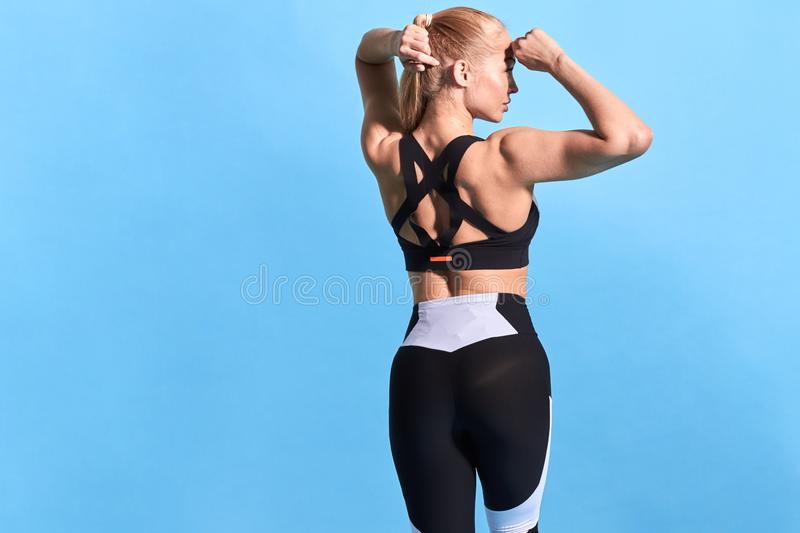 Slim muscular strong woman preparing for a competition royalty free stock photos