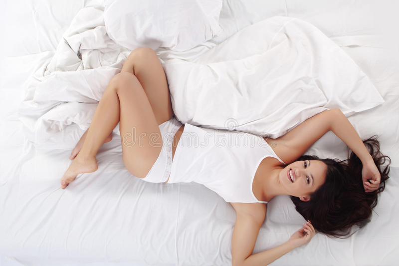Slim sexy woman in bed