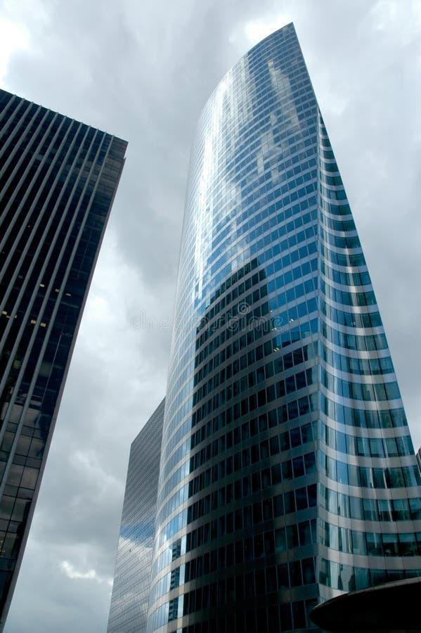 Slim skycraper, skew view. Beautiful, slim skycraper over cloudy sky, La Defence district, Paris royalty free stock image