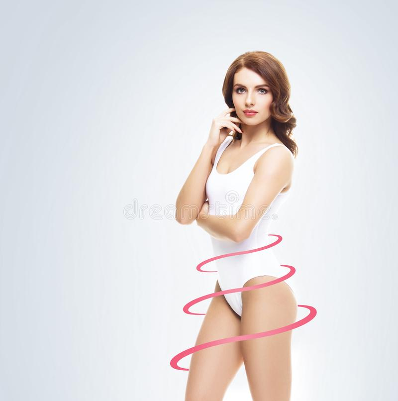 Slim and sporty female body. Fit and healthy girl in swimsuit. Health, sport, fitness and weight loss. stock images