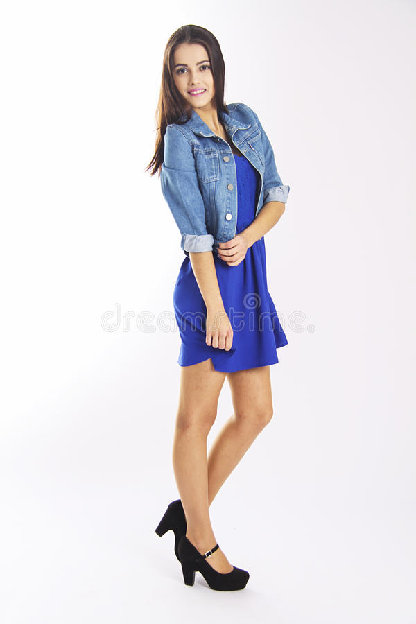 Slim student girl in blue casual dress stock photo