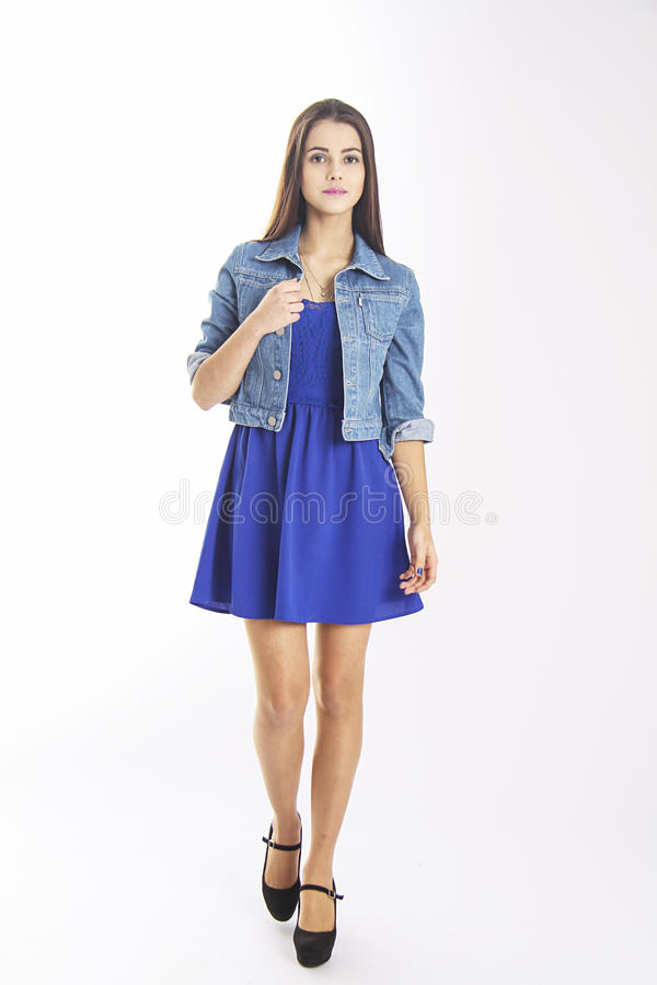 Slim student girl in blue casual dress royalty free stock photography