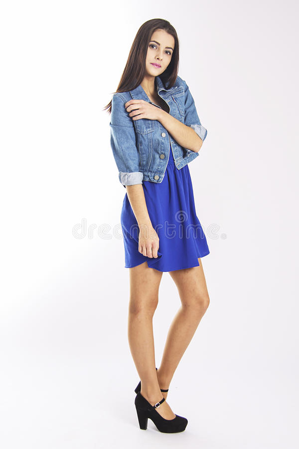 Slim student girl in blue casual dress stock image