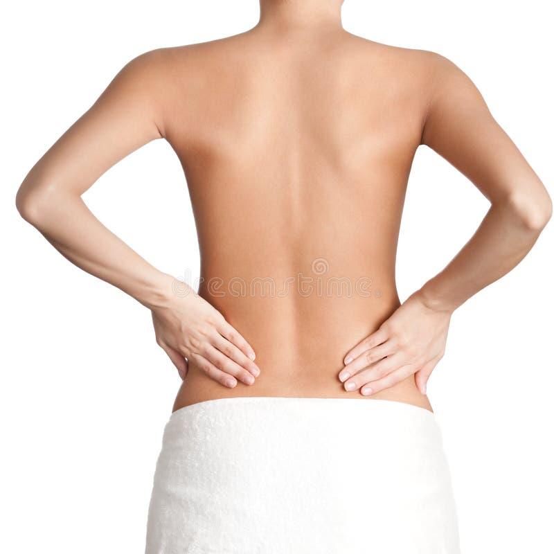Slim waist of athletic woman. Isolated, white background stock photos
