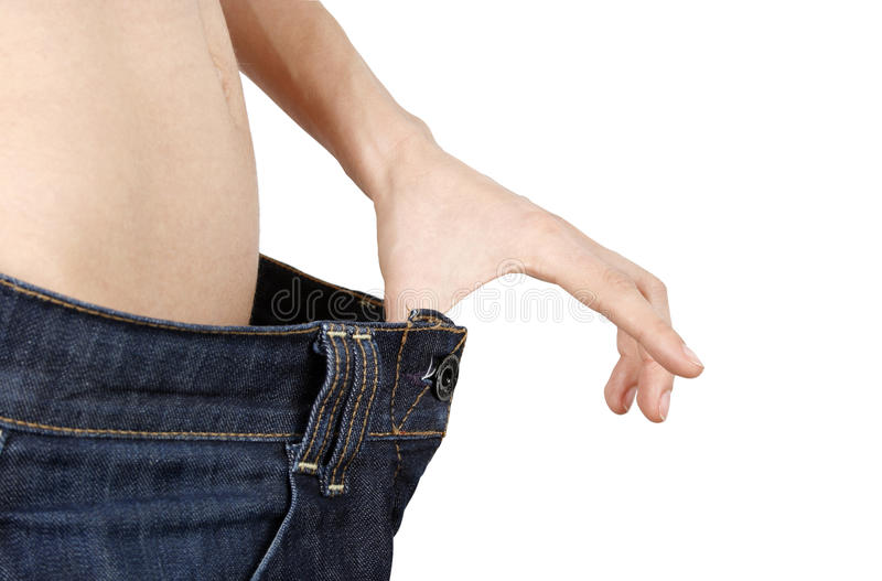 Slim woman in big jeans stock images