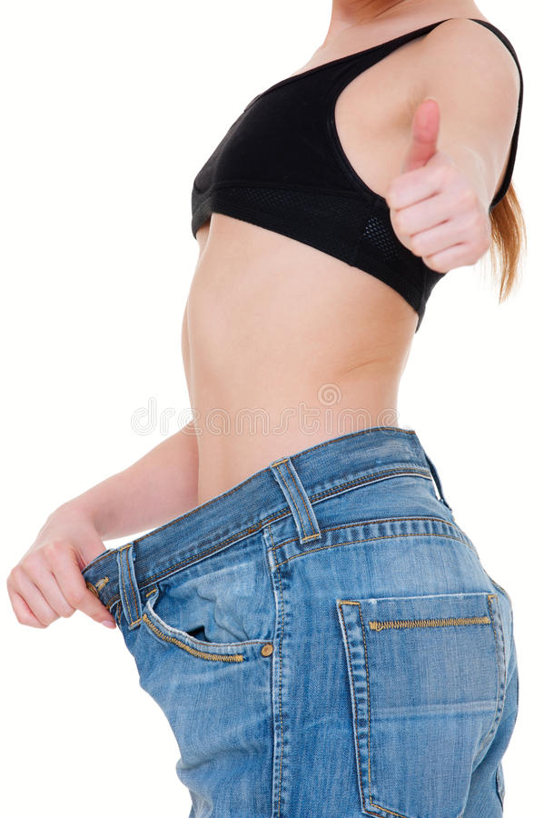 Slim woman in big jeans royalty free stock photo