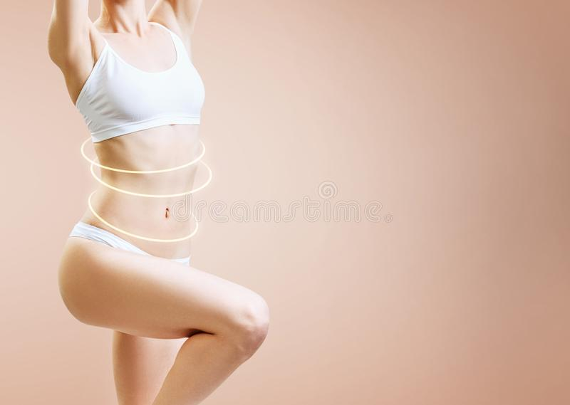 Slim woman body with glowing circles shows lifting effect. royalty free stock images