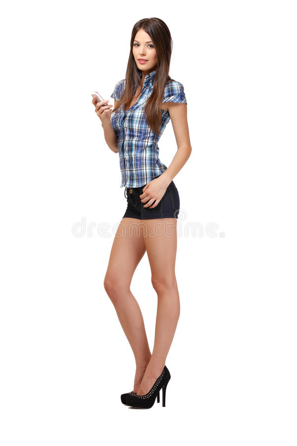 Slim woman with cellphone on white royalty free stock images