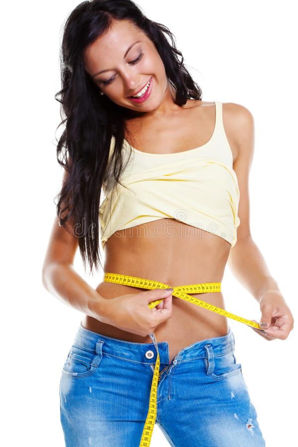 Slim woman in jeans with tape measure stock photos
