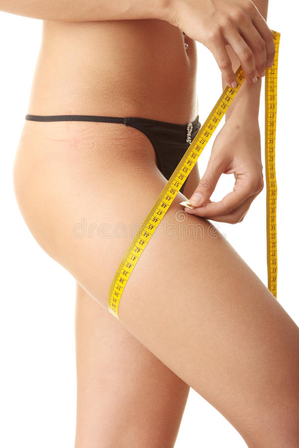 Download Slim Woman Measuring Her Leg Stock Photo - Image of centimeter, instrument: 10296702