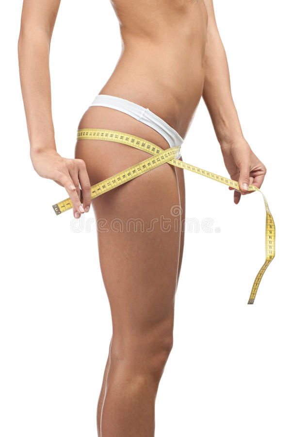 Slim woman measuring perfect shape of her hips royalty free stock images