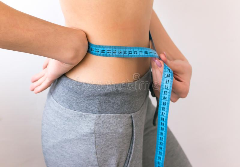 Woman measuring her waist Wellness concept. royalty free stock images