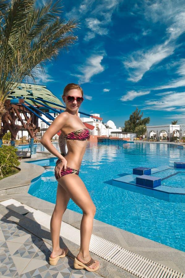Download Slim woman near pool stock photo. Image of heart, pool - 22548056