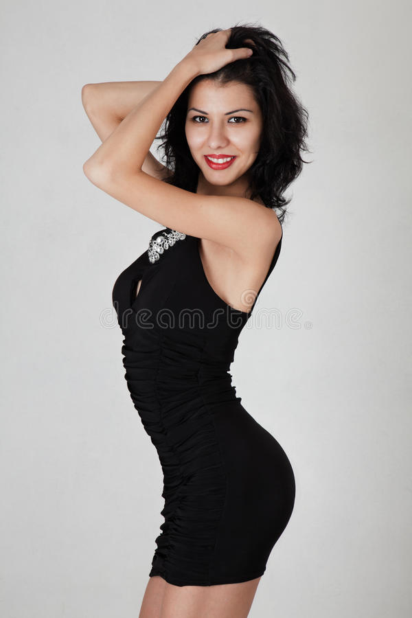 Slim woman posing royalty free stock photography