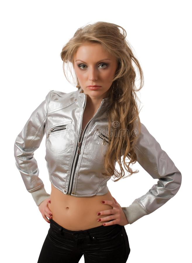 Slim young female in silver jacket