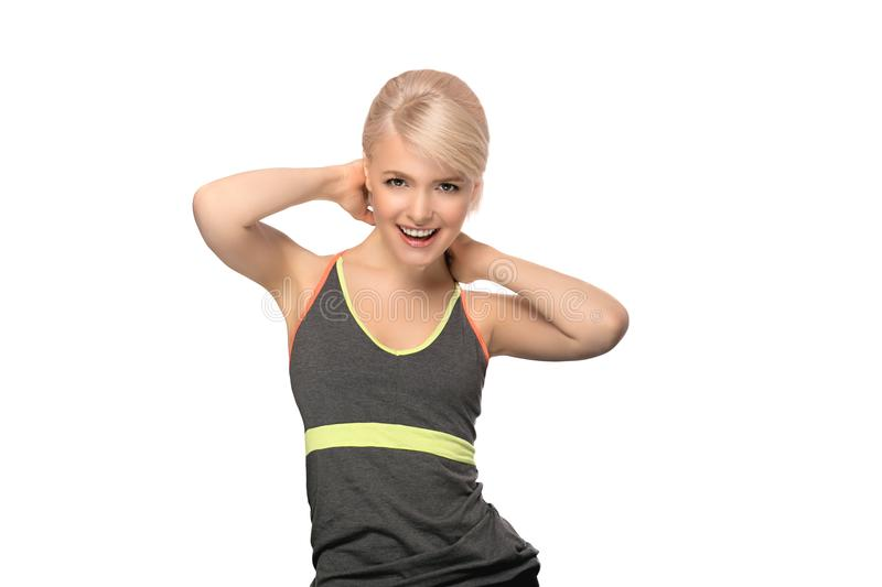 Fitness woman on white background. Slim young fitness woman in sport style isolated on white background royalty free stock images