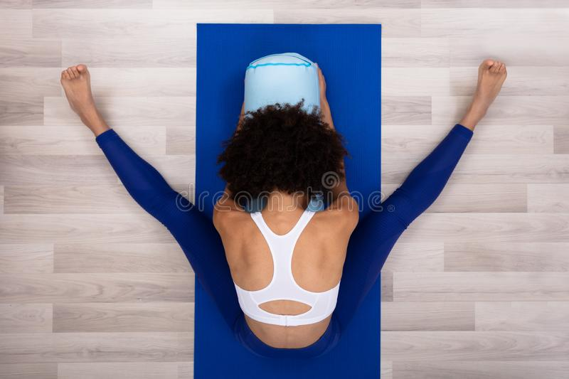 Slim Young Woman Exercising At Home stock photo