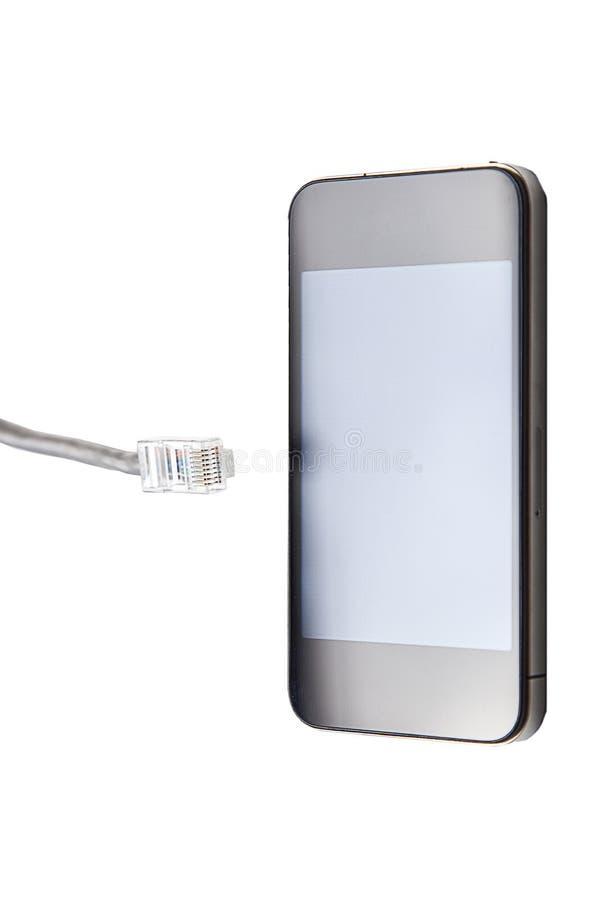 Slimme telefoon met de stop van de gegevenskabel over witte achtergrond royalty-vrije stock foto