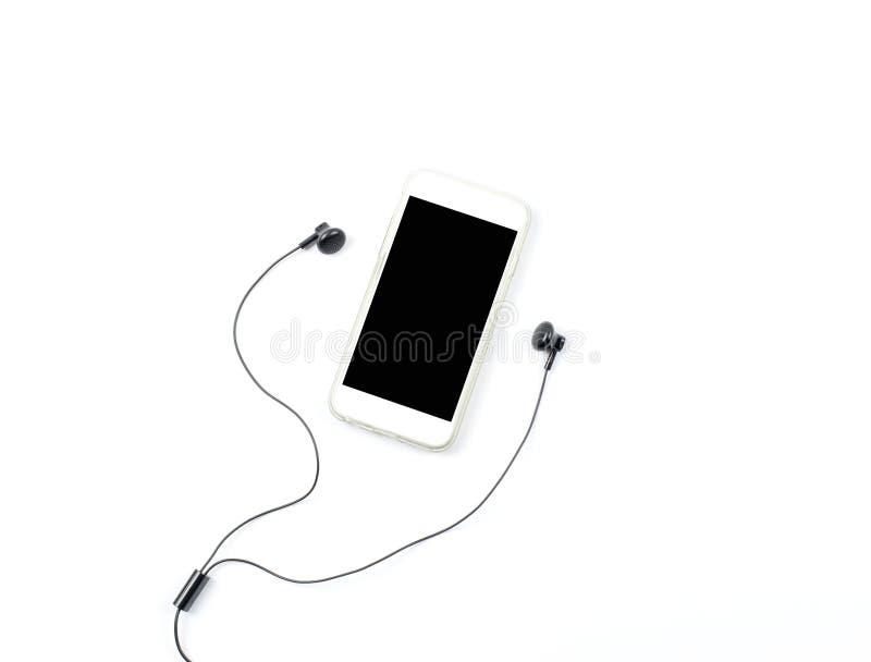 slimme telefoon met zwarte oortelefoon royalty-vrije stock afbeelding