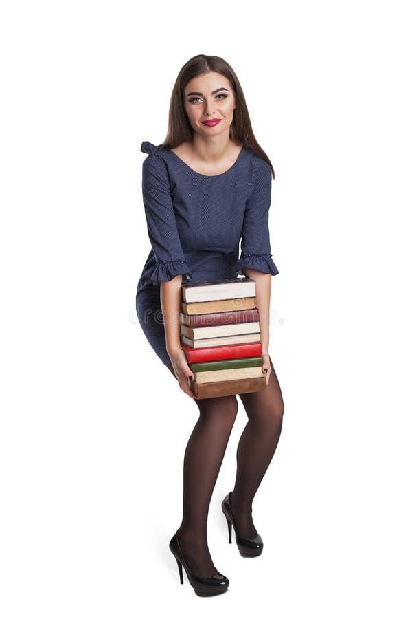 Slimme vrouw met boeken royalty-vrije stock fotografie