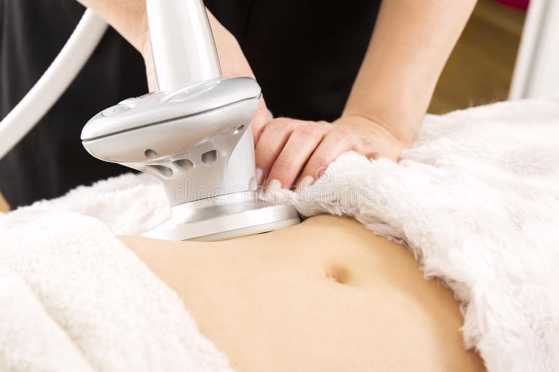 Slimming and cellulite laser treatment at clinic stock images